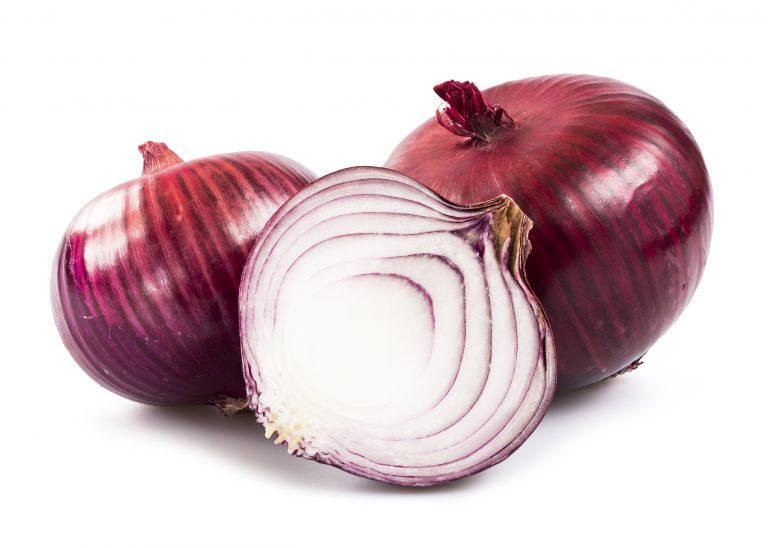 Red onion over white background
